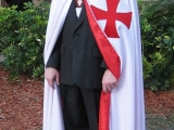 "<p>A man induced into the Knights Templar (Freemasonry) in 2009. Note the Maltese Cross.</p> <p>&nbsp;Watch&nbsp;<a href=""https://amazingdiscoveries.tv/media/123/211-the-secret-behind-secret-societies/"">The Secret Behind Secret Societies on ADtv</a>&nbsp;for more information.&nbsp;</p>"