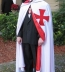 <p>A man induced into the Knights Templar (Freemasonry) in 2009. Note the Maltese Cross.</p> <p>CC Danny Thompson https://commons.wikimedia.org/wiki/File:Templar_induction_2009_3.jpg#mw-jump-to-license</p>