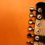 View of the top of a black electric guitar with copy-space Fotolia © Kristian Peetz