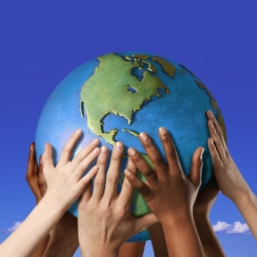 Hands on a globe --- Image by Royalty-Free/Corbis