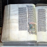 https://commons.wikimedia.org/wiki/File:Bible.malmesbury.arp.jpg     A Bible handwritten in Latin, on display in Malmesbury Abbey, Wiltshire, England. The Bible was written in Belgium in 1407 AD, for reading aloud in a monastery.