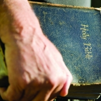 Permission for a single online usage http://www.istockphoto.com/photo/antique-bible-in-hand-5708918?esource=AFF_IS_Linkconn_SP_www.freeimages.com_141052&asid=308966&cid=5418&lid=13