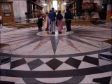 "<p>In front of the main altar of St. Paul's Cathedral, you find the typical solar symbols associated with <a title=""Read our article on Sun Worship"" href=""../S-deception_end-time_paganism_Catholic_sun-worship"" target=""blank"">sun worship</a>. <br /><br /></p>"
