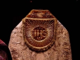 "<p>The letters ""IHS"" are embroidered on the vestments in St. Paul's Cathedral in London. <a href=""../albums.html?action=picture&aid=5428977213518190017&pid=IHS.jpg"" target=""blank"">IHS</a> is the ancient abbreviation for the three gods Isis, Horus, and Set, who played a prominent role in ancient pagan sun worship religions. Nowadays some say that these letters stand for ""In His Service,"" but the straight and curved sun rays emanating from the letters give it away as just another pagan symbol that has infiltrated the once Protestant Church of England.</p> <p>Watch our ADtv video <a href=""https://amazingdiscoveries.tv/media/137/224-that-all-may-be-one/"">That All May Be One</a>. </p>"