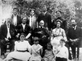 <p>Ellen White surrounded by family, 1913.<br /><br /></p>