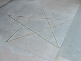 <p>A pentagram in the cement outside a masonic lodge.</p>