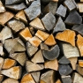 Plenty of firewood of different colors and textures, show annual growth rings. The logs are stacked up to dry, some with the back up, again a wall at the back of the house. The older ones are dark grey while the newer are light brown. https://www.flickr.com/photos/horiavarlan/4273110809/in/photolist-8EFmRp-7vv5K8-7vBsBe-7v5MT7-7v2dP8-7vERTY-7vANYi-7Ljkjc-7vFnoY-7z7EwP-7vBBWX-8wP3pU-7ve3KC-7vBxfe-7Ayafz-7vc4ai-7vvrSH-7N5WAG-7vByFc-7AQAwb-7vADoc-8NcrZZ-7vfzgW-7vExqC-7veBc7-7vByvx-7vBfq2-7Phb8q-7veVzE-7vFnwb-7vAHW8-7va2XR-7vb7sM-7vdRkb-7vfMoy-7vc3KD-7v78LY-7xmVf5-7vc4pv-7vEgTW-7zQYgt-7xGqLH-7vvRZ8-7xPDe2-7vfRMS-859yYb-7vbe64-7K8r2i-7vbLjF-7vjnzL