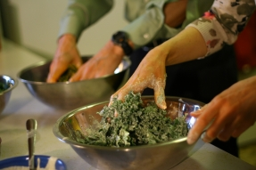 Massaging the flavor into the kale.