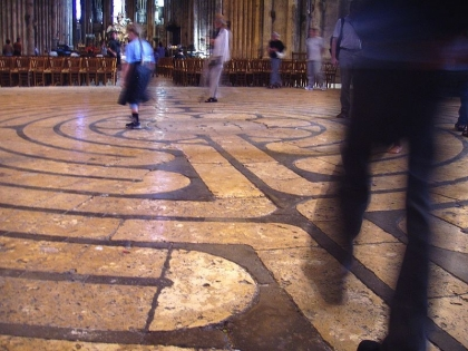 A famous labyrinth on the floor of Chartres Cathedral in France. Source: Wikimedia Commons.