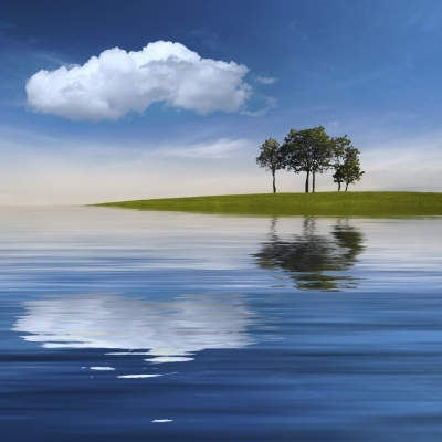 Some trees on a green island under the deep blue sky... and the reflecting water all around.