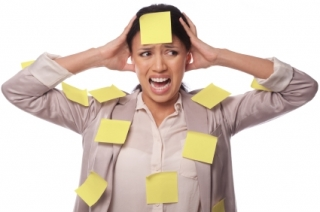stressed-out woman with yellow sticky notes all over her body