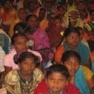 Group of people in India listening to evangelism series
