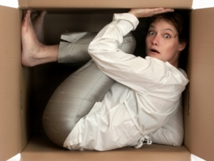 young woman trapped in a cardboard box