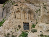 "<p>An ancient pagan place of worship built into the hillside in Syria where the monastery of Saydanaya is located. The pagan worship cave is sealed with the black iron door. Triple arches were common in pagan worship and are also used in Mary veneration. On the top of this hill is a monastery containing a <a title=""Syrian Icon, Weeping Statues Gallery"" href=""../albums.html?action=picture&amp;aid=5423351265370254289&amp;pid=Saydanaya+icon.jpg"" target=""blank"">painting that drips oil</a>. Catholic structures are often built over ancient pagan sites. <br /><br /></p>"