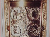 <p>Golden door in the chapel of St. Ignatius in San Francisco showing the peacock, phoenix, dragon-fish, unicorn, pagan mitre and staff, and a P with crossed feathers (a 666 symbol also used in freemasonry). </p>