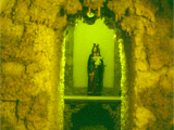 "<p>Mary statue in a grotto. Note the ""Maria"" inscription above the archway. The ""M"" is a masonic symbol. </p>"
