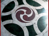 <p>Original triple yin yang symbol with sun blas&eacute; on floor of a Roman Catholic cathedral in London. </p>