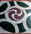 <p>Original triple yin yang symbol with sun blasé on floor of a Roman Catholic cathedral in London. </p>