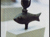 <p>A fish icon from ancient Egypt shown here with the horns of the bull on top. The bull represented the elephant. These creatures become symbols of the sun god, which is why you see bull worship and elephant worship. The horns between the eyes of the bull are also a symbol of the half moon or sickle moon, which becomes the womb of the woman which receives the rebirth of the sun god. </p>