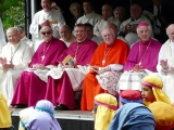 <p>Catholic Cardinals in purple and red.</p>