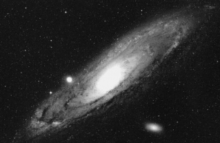The Andromeda Galaxy. A spiral galaxy, illustrating that matter and systems are organized in the universe and not evenly distributed throughout the universe as predicted by the cosmological principle which is the basic philosophy on which the Big Bang theory rests.