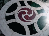 "<p>A triple yin yang, or triskele, on the floor of a cathedral in London. The triskele is ""a Celtic version of the Yin-Yang symbol of life"" (<em>The Brookridge Forum</em>, Winter 1987-1988, Vol. 3: 1), and a modification of the <a href=""http://amazingdiscoveries.org/albums/p/5602900391684397345/Hitler-Nazi-Flag.jpg"" target=""blank"">swastika</a> (<a href=""http://www.sacred-texts.com/sym/mosy/mosy01.htm"" target=""blank"">Count Goblet D'Alviella, <em>The Migration of Symbols</em>, Westminister: Archibald Constable and Company, 1894: xi</a>).</p>"