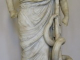 "<p>This statue of the Greek god of medicine, Asclepius, is found in the Pergamon Museum in Berlin.<br /><br />Watch&nbsp;<a href=""https://amazingdiscoveries.tv/media/119/207-seven-churches/"">Seven Churches on ADtv</a>&nbsp;for more information.</p>"