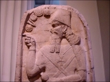 "<p>This Assyrian king is wearing a Maltese cross, just like the one seen on the Pope's robe. Notice also the <a title=""Read our article: Sun Worship Symbols"" href=""http://amazingdiscoveries.org/S-deception_paganism_Catholic_symbol_St-Peter"" target=""blank""> sun worship symbols</a> above his hand. The symbol above his hand is the 8-spoked pagan solar wheel. <br /><br />Copyright Amazing Discoveries.</p>"