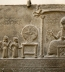 "<p>Babylonian King worshiping the sun god Shamash. The sun disc and other symbols represent the moon god, the sun god, and the goddess Ishtar. <br /><br /></p> <p>Watch<a href=""https://amazingdiscoveries.tv/media/132/219-the-wine-of-babylon/""> The Wine of Bablyon on ADtv</a> for more information.</p>"