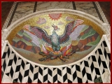 "<p>This phoenix rising as seen in the Westminster Cathedral in London shows the black and white diamonds represent the light and dark side of Lucifer, the light bearer. The black and white is also used in freemasonry. The phoenix rising from the ashes symbolizes the light bearer being resurrected. <br /><br /></p> <p>Watch<a href=""https://amazingdiscoveries.tv/media/132/219-the-wine-of-babylon/"">&nbsp;The Wine of Bablyon on ADtv</a>&nbsp;for more information.</p>"