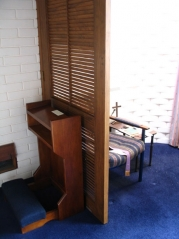 A modern confessional at the Church of the Holy Name in Dunedin, New Zealand. Source: Wikimedia Commons.