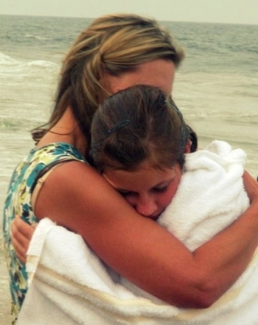 A teenager hugs her mom after being baptized in the ocean.Source: eren on Flickr.