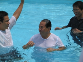 A baptism by immersion is celebrated in the Philippines.Source: David Quitoriano on Flickr.