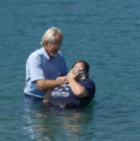 A young woman is baptized by immersion in Illinois in 2009.Source: Douglas Couture on Flickr.