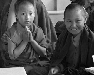 Young monks at the front door of Tharlam Monastery, Boudha, Kathmandu, Nepal