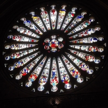 Angers Cathedral South Rose Window of Christ (centre) with elders (bottom half) and Zodiac (top half). CC BY-SA 3.0 Chiswick Chap https://commons.wikimedia.org/wiki/File:Angers_Cathedral_South_Rose_Window_of_Christ_with_Zodiac.jpg