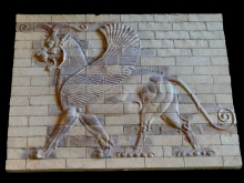 A winged horned lion with horse neck and eagle posterior legs from the famous glazed bricks friezes found in Darius the Great's palace in Susa by archeologist Marcel Dieulafoy. CC Sharealike dynamosquito on Flickr https://www.flickr.com/photos/dynamosquito/2814125967/in/photolist-5hDb9L-5gHcTY-5hF8Be-7RmHXj-4CaJHU-76wT6D-4GPDRi-6zHQVu-76wXrP-82RzSS-5Pi7Qx-5Pi6cB-61SYNa-8bnb7h-9HJLYa-61XaJW-9Cn2Gb-8bnaLf-8bn9Jo-82Nsye-8bn7cL-8bn7Y9-8biQXF-8biQi2-8bn6S5-8bn6s5